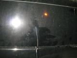 cracked panel below the rear window
