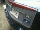 plastic cover for license plate light fell off