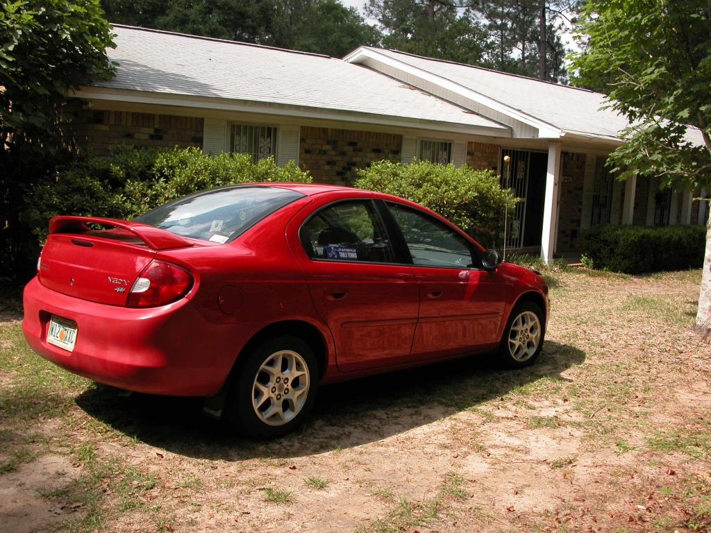 2002 dodge neon back bumper is a different shade of red. Black Bedroom Furniture Sets. Home Design Ideas