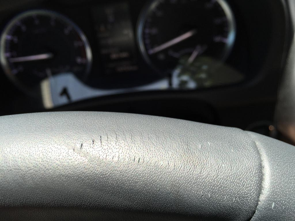 2015 Toyota Highlander Leather On Steering Wheel Defective