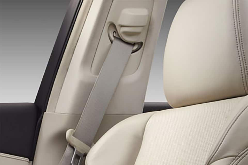 A beige interior featuring the headrest of an unnamed Acura vehicle.