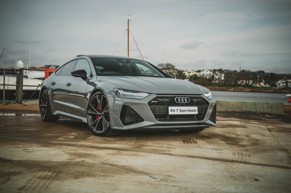 Gray RS 7 Sportback on a concrete dock near the water