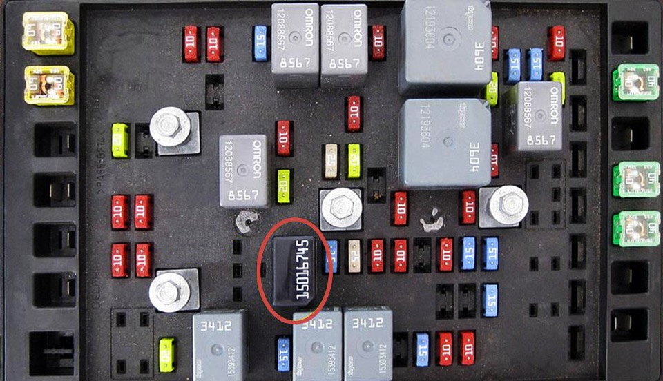 An open fuse block with the bad module circled in red