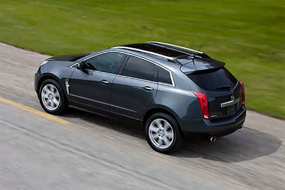 Overhead view of a black SRX rolling down the road