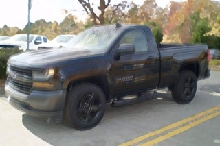 A blurry image of a Silverado that looks like it's bouncing up and down.