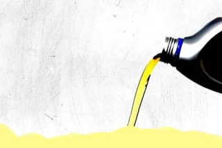 An illustrated oil bottle pouring out a yellow-green oil.