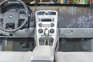 A Chevy interior with super-imposed animated snowflakes on top.