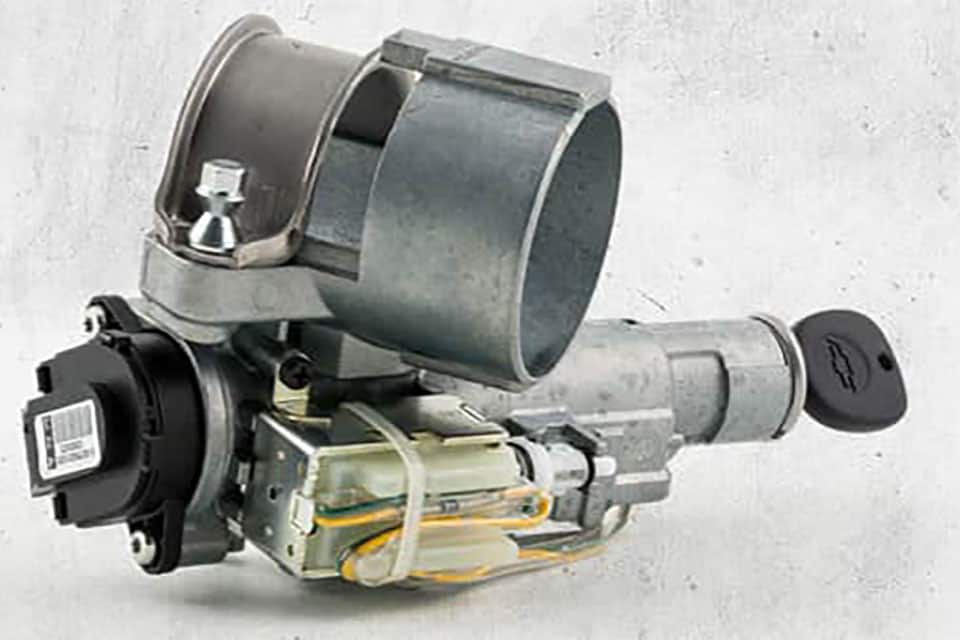 An isolated ignition switch on a gray background.