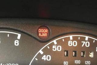 An illuminated door ajar warning light