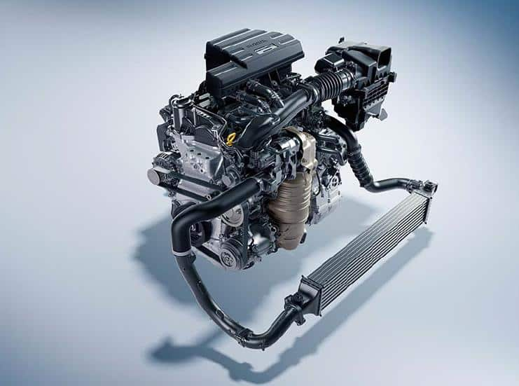 An isolated Honda engine on a white to blue gradient background.