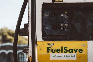 A yellow and white gas pump with the words Fuel Save on the front