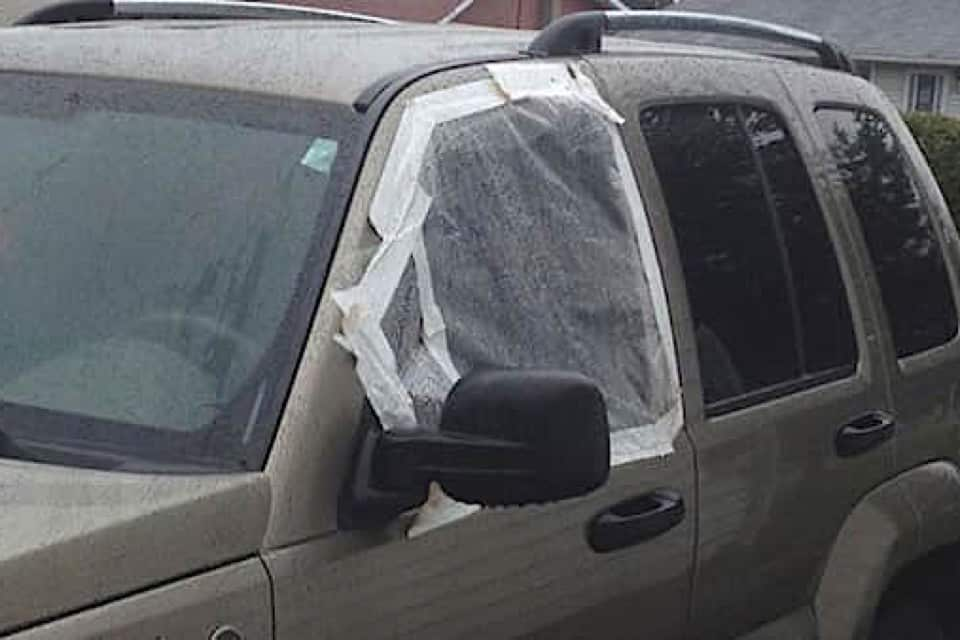 A missing Jeep window that's all taped up