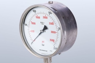 A pressure manometer with the arrow pointing to zero