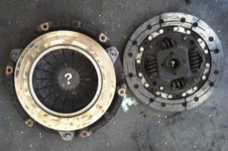 Disassembled clutch with a skull and cross bones