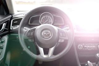 Interior view of Mazda with intense glare off dashboard