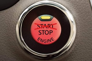 Push start ignition with start crossed out and replaced with stop
