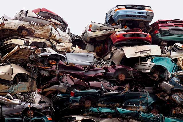 A large pile of crushed cars