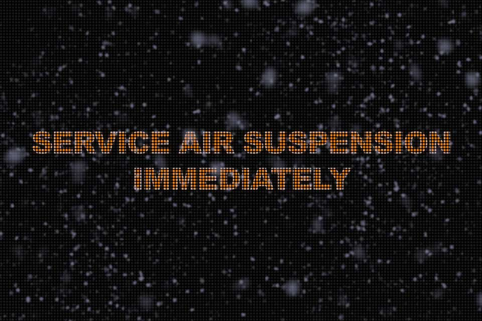 Console Message That Says Service Air Suspension Immediately, With Fake Ice on Top