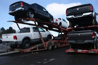 A group of Ram trucks on a tractor trailer