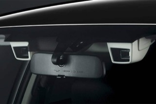 Image looking through the windshield towards a pair of EyeSight cameras flanking the rearview mirror.