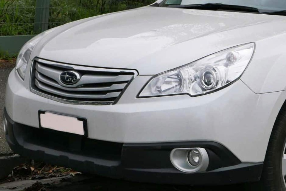 Headlights on a white Subaru Outback