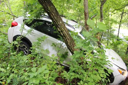 White Crosstrek crashed on an embankment