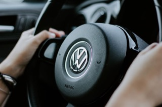 A steering wheel with the VW emblem in the middle