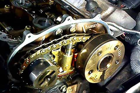 Gold timing chain in a VW engine