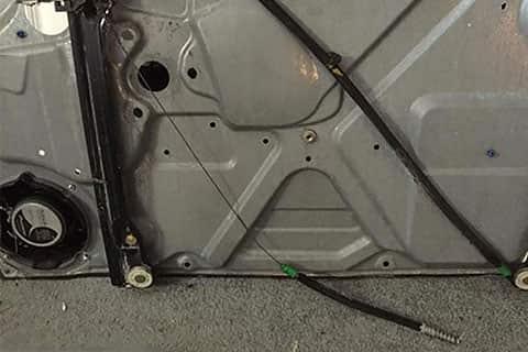 VW door disassembled to show window regulator