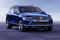 A shiny blue Touareg hybrid on a studio backdrop