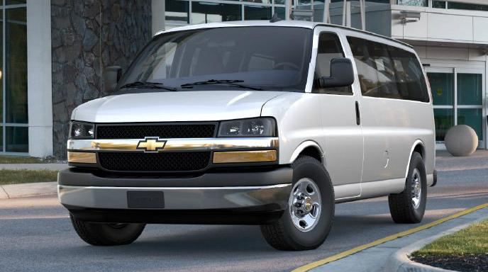 Front 3/4 view of a white Chevy Express van