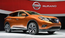 A bright orange Murano in front of the Nissan logo at a car show