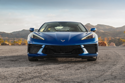 Blue Corvette with golden hour mountains in the background