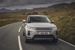 Gray Range Rover Evoque SUV on a country road.