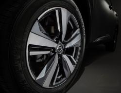 A close-up of a aluminum Nissan wheel
