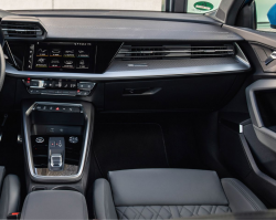 Inside view of the passenger side of an Audi vehicle with black leather seats