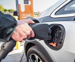 Car owners about to plug-in to an EV charging station