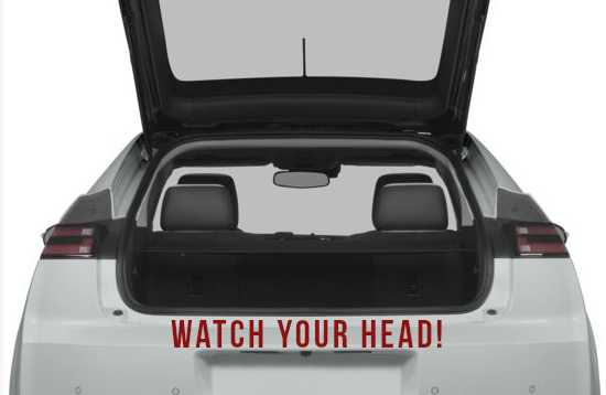 An open trunk with the words 'watch your head' written below
