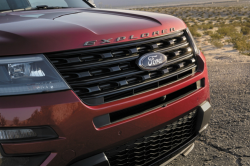 The grille of a red Ford Explorer