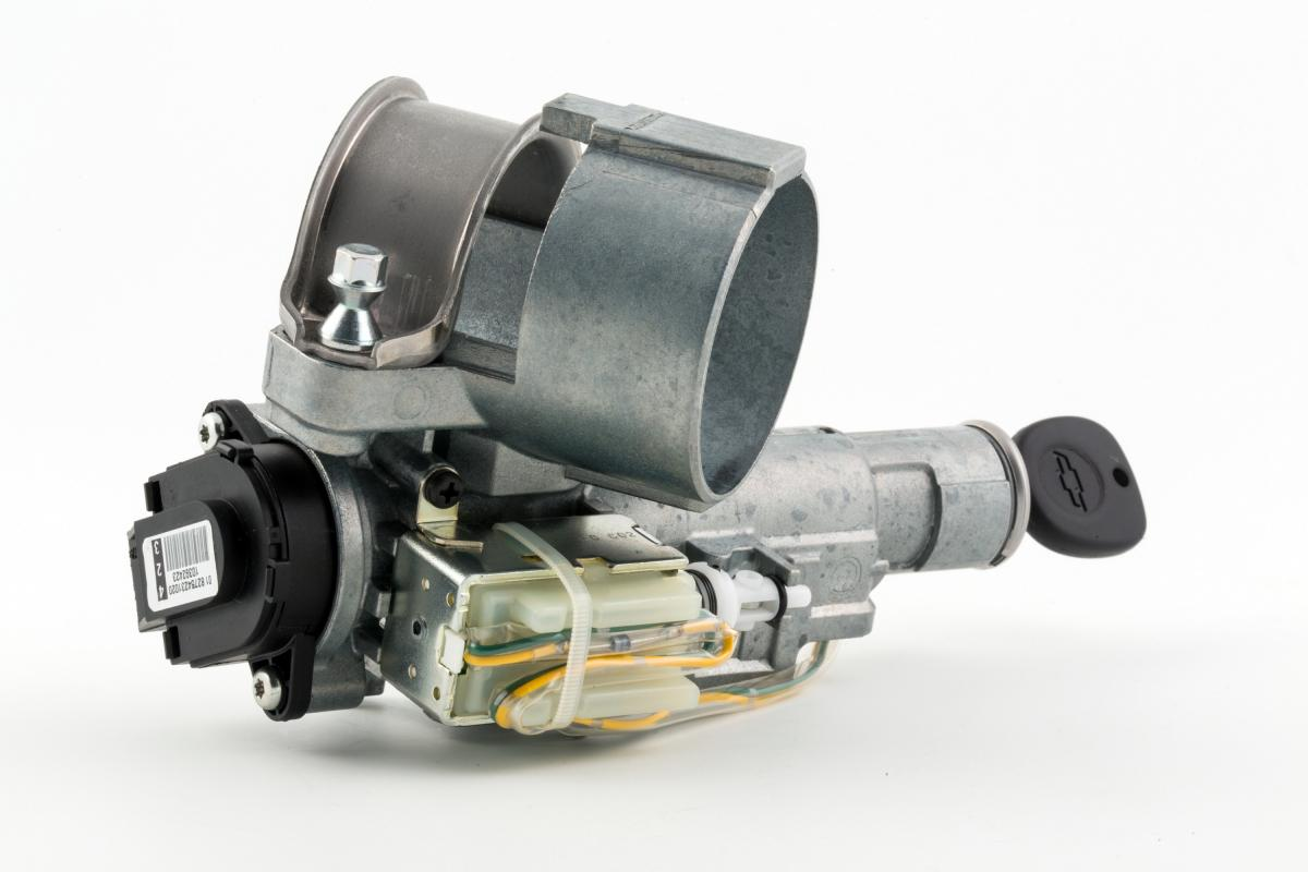 An isolated ignition switch component on a white background