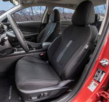 Looking through an open drivers-side door into a Hyundai Elantra