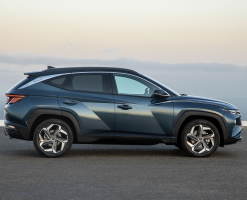 Side-view of a blue Tucson