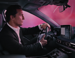 Actor Matthew McConaughey driving a Lincoln vehicle