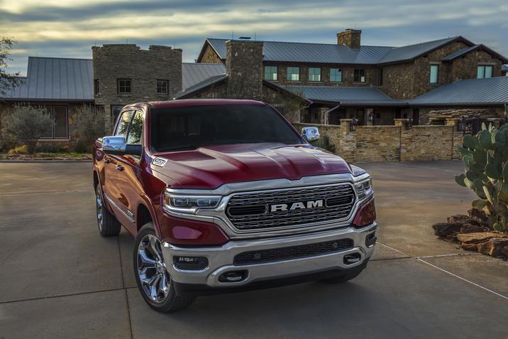 Red Ram truck in a driveway