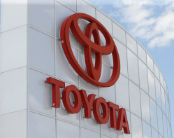 Toyota logo on the side of a glass building
