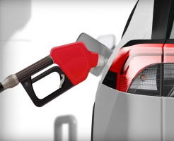 Close-up of car with gas nozzle in the tank